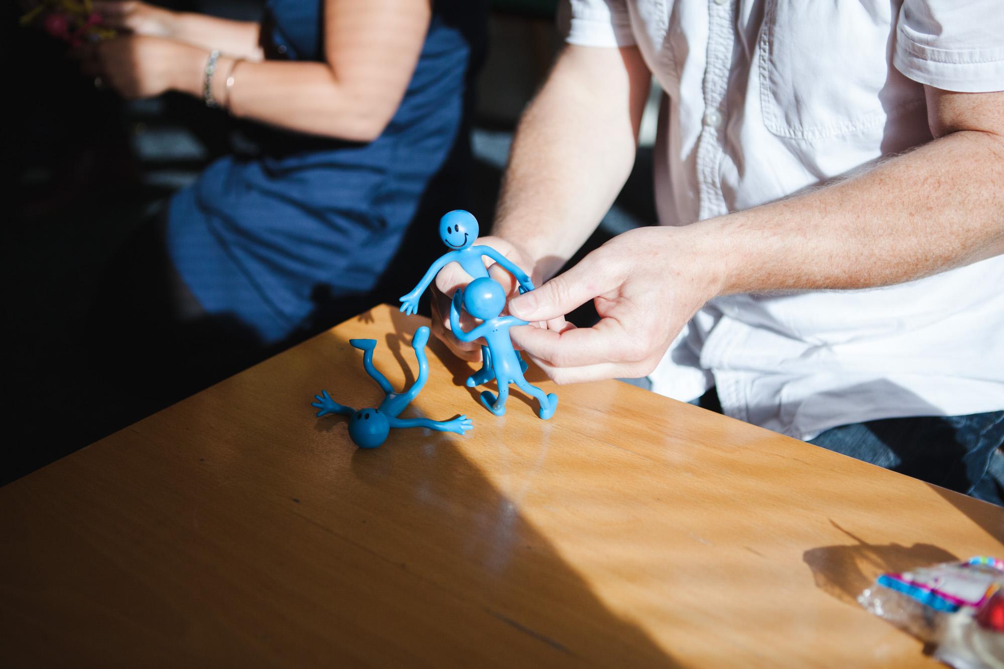 training course, facilitator explaining using plastic figures